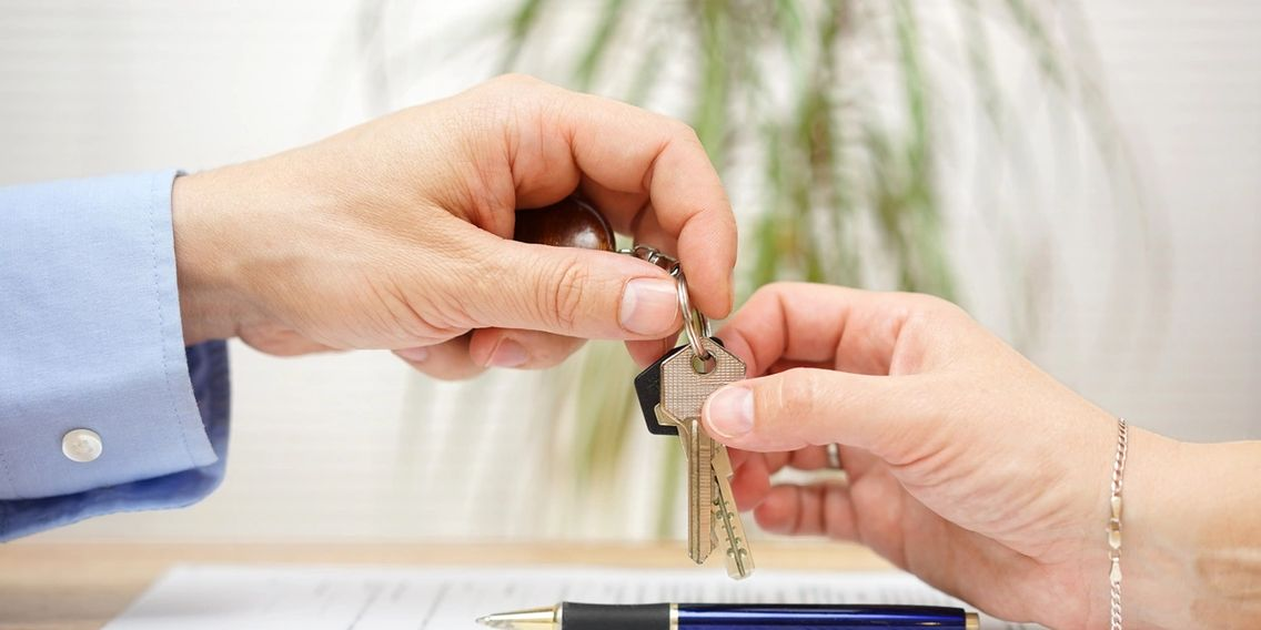AZ Financial, LLC giving keys to newly purchased home.