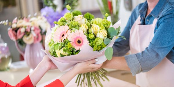 florist handmade bunch bouquet delivering flowers to customer