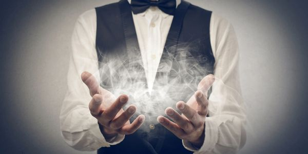 magician producing smoke from his hands