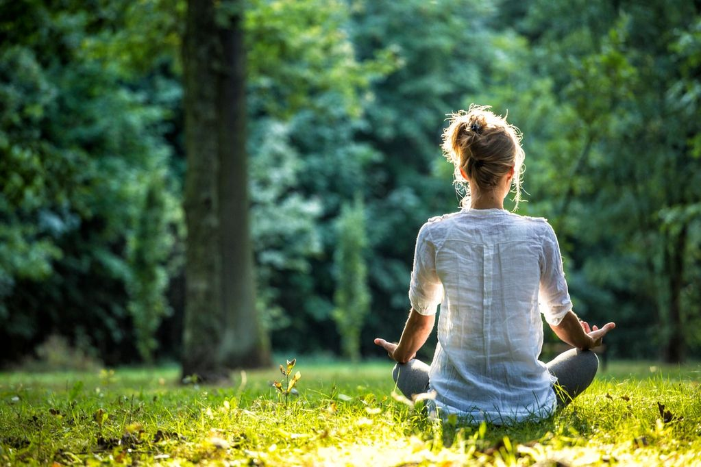 woman in field  meditating mental health check