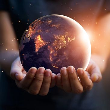 Personal holding the Earth in their hands.
