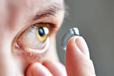 This page shows our Eye doctor Inserting ontact lenses.