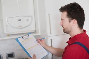 Man checking a central heating boiler