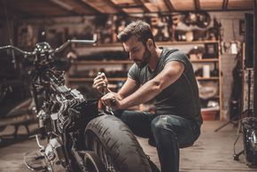 Person working on a motorcycle