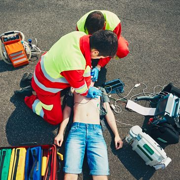 Paramedics perform CPR on a patient in cardiac arrest.