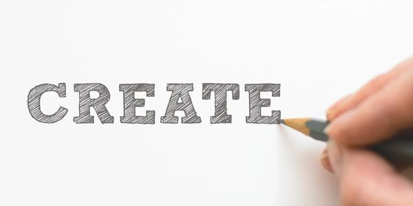 A photo of writing the word 'create', representing Chinese transcreation services.