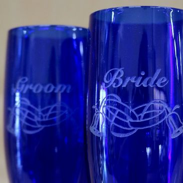 Wedding glasses can be laser etched or sandcarved for an elegant gift.