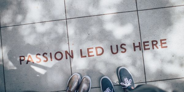 "Writing on the path ""Passion Led Us Here"" Chartered Surveyor Project Management"