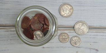 money in a jar for a corporate finance workshop