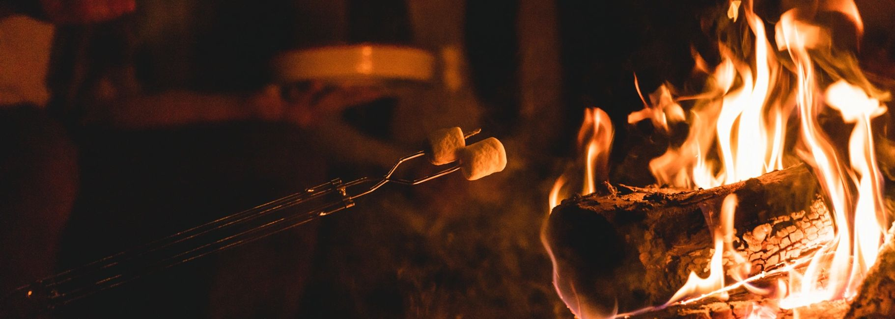 Roasting marshmallows over a campfire.