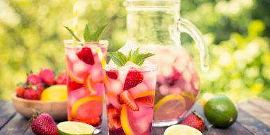 A jug of sangria, some fruit and sangria in glasses