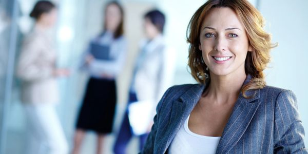 Woman business professional is smiling after completing the work
