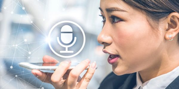 picture of a woman speaking into her smartphone microphone.