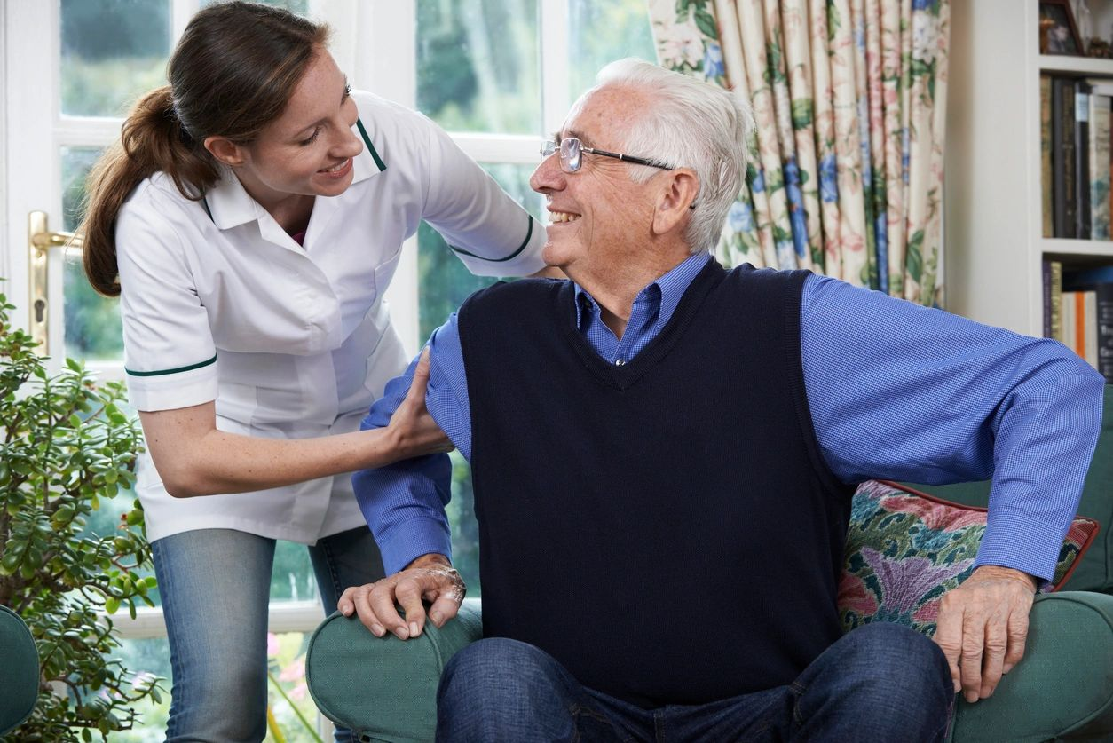 Caregiver  assisting their loved one