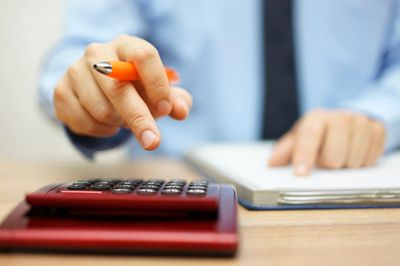 finsncial adviser making calculations relating to financial advice at protect and prosper.