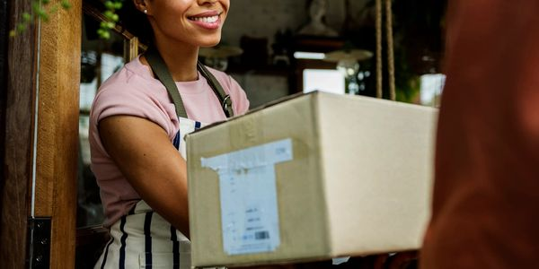 Woman receiving packages from a delivery person