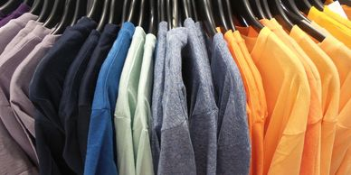 Clothing rack of different colors of t shirts