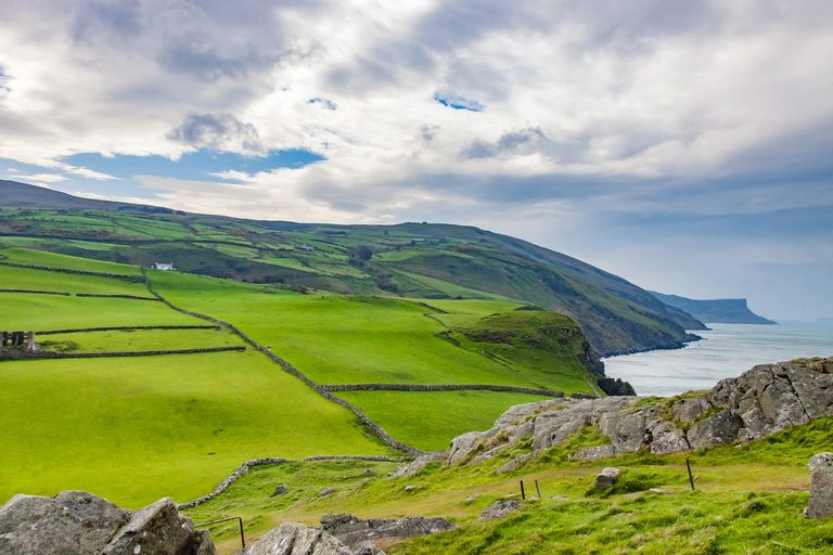 Ireland coastline green fields hibernian Irish farmland